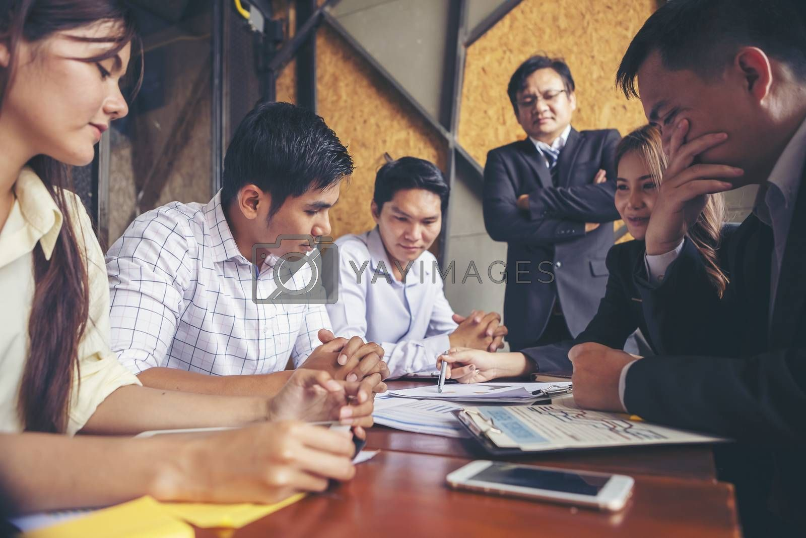Group of young businessmen are meeting and presenting a plan for successful marketing and business planning.