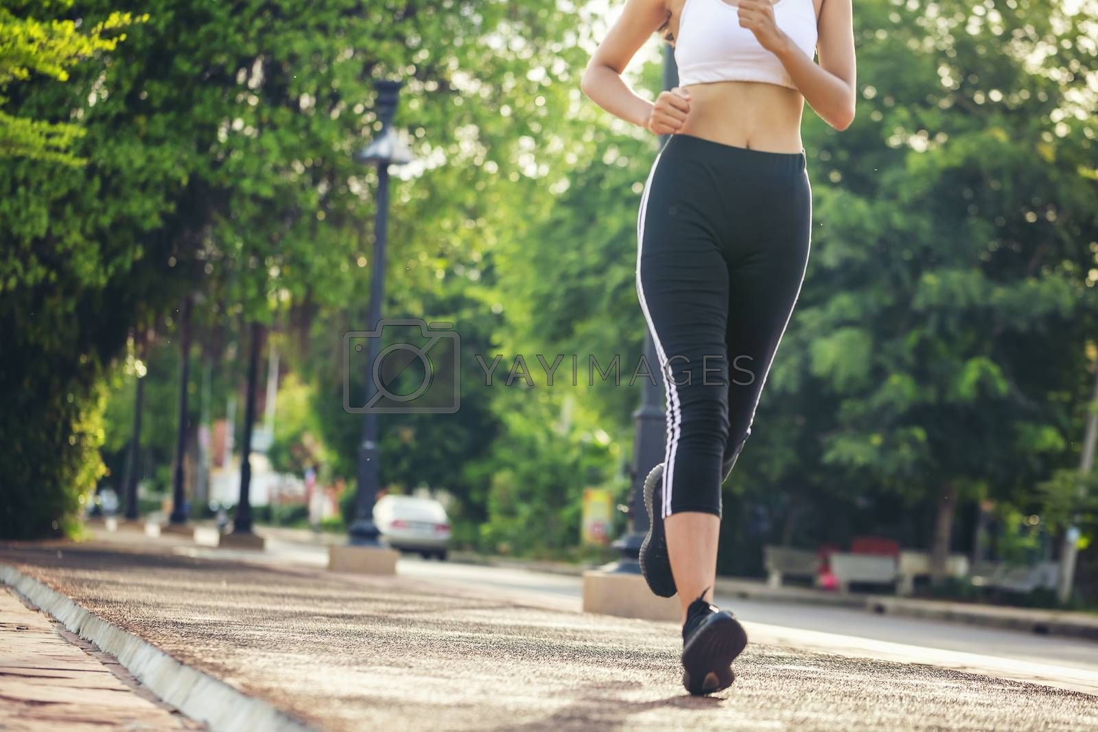 Beautiful woman jogger outdoor living healthy lifestyle in city  by numberone9018