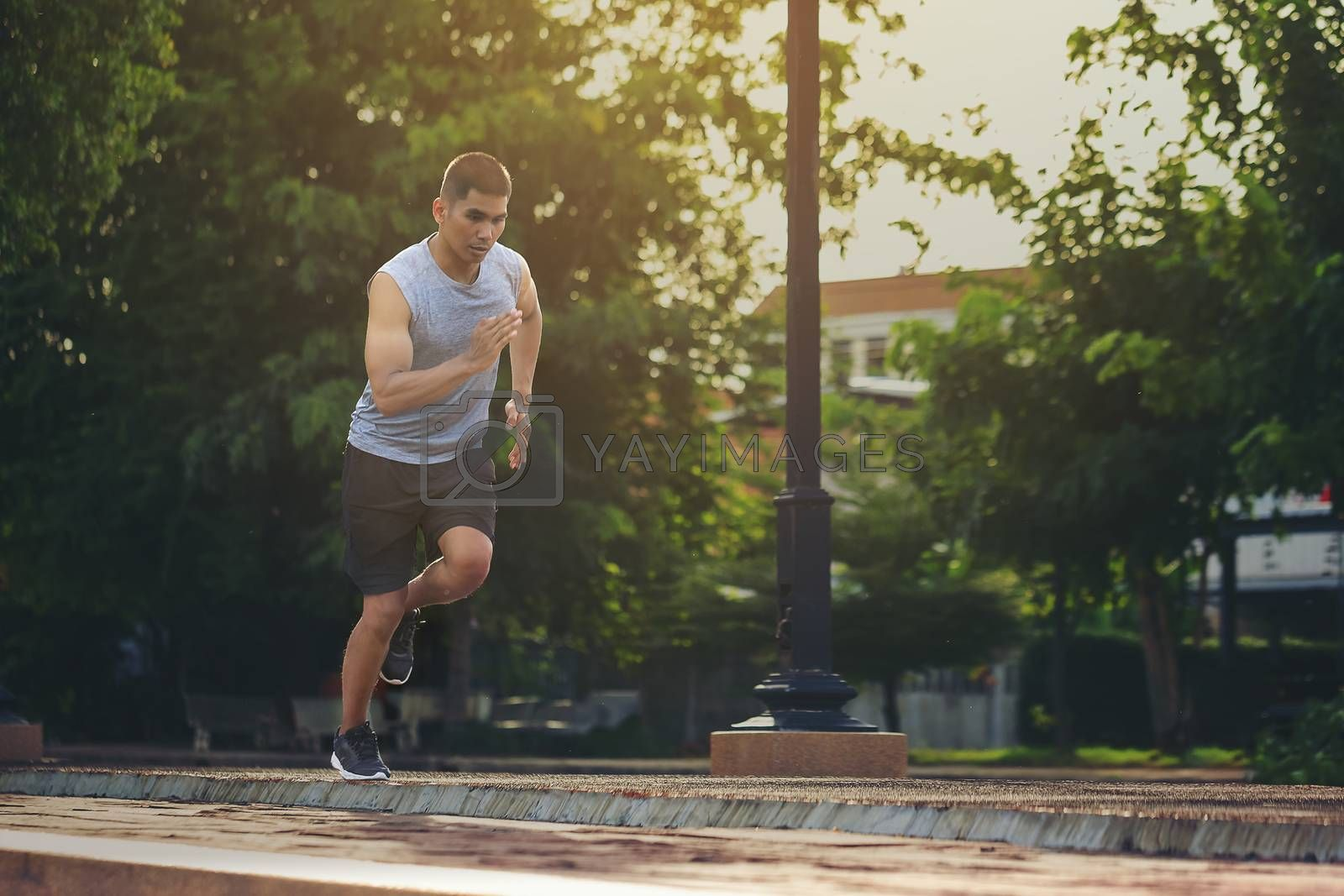 Portrait of fit and sporty young man running in the city. Concep by numberone9018