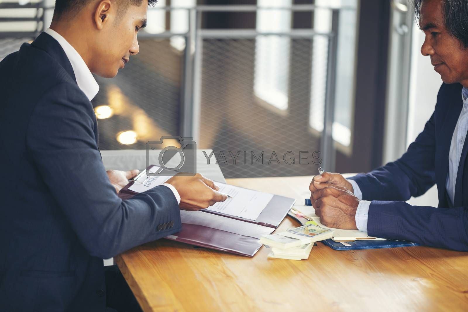 Image of business people hands working with papers at meeting. B by numberone9018