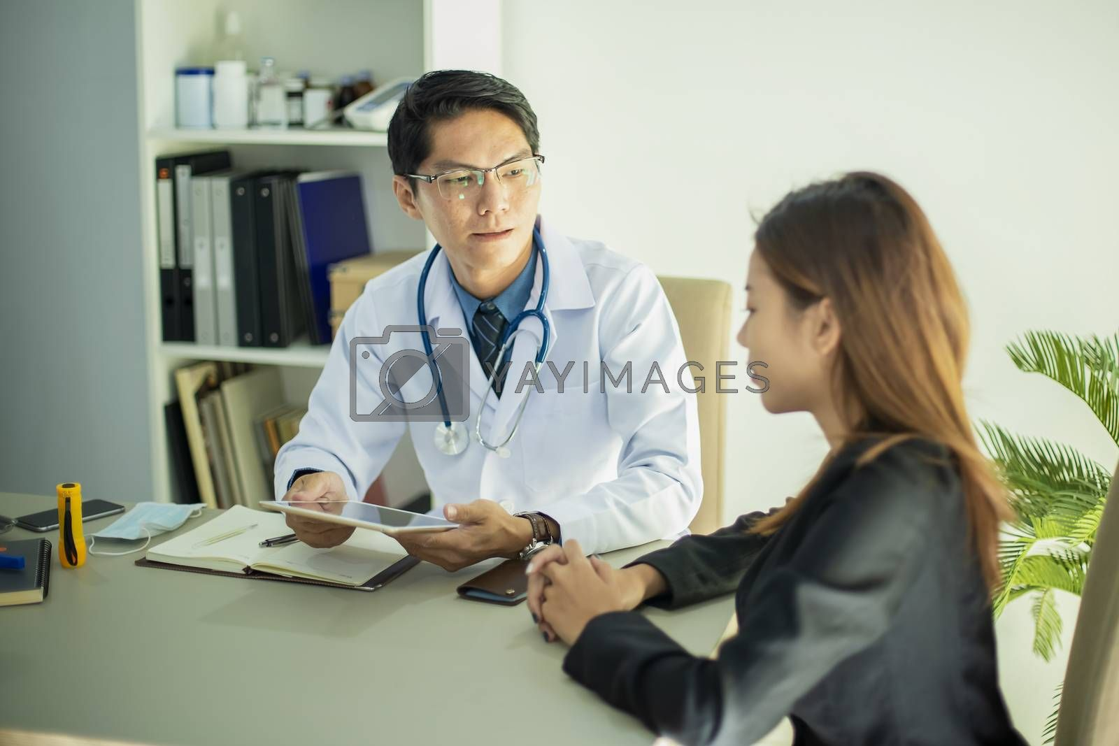 Portrait of a doctor consulting with a young woman about body health care and explain about the correct medication usage