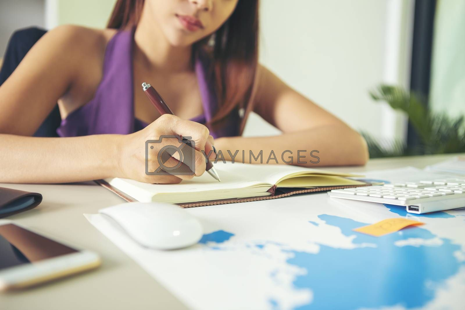The image of a beautiful young business woman working tensely wi by numberone9018
