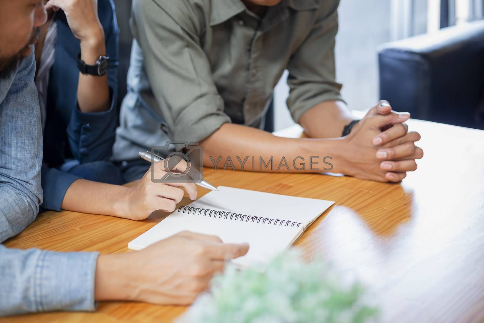 The hand of a business man discuss financial documents. businessmen and customers are negotiating a trade agreement