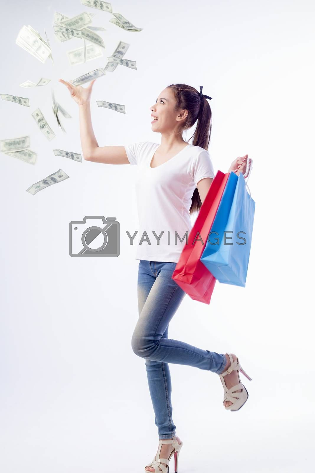 Portrait of a beautiful woman in her hand Carrying money and a colorful shopping bag, isolated on white background