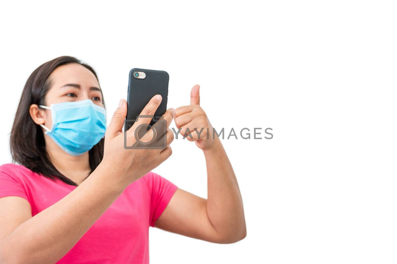 Corona virus (COVID-19), During detention at home Masked women use phones to make video calls to friends.