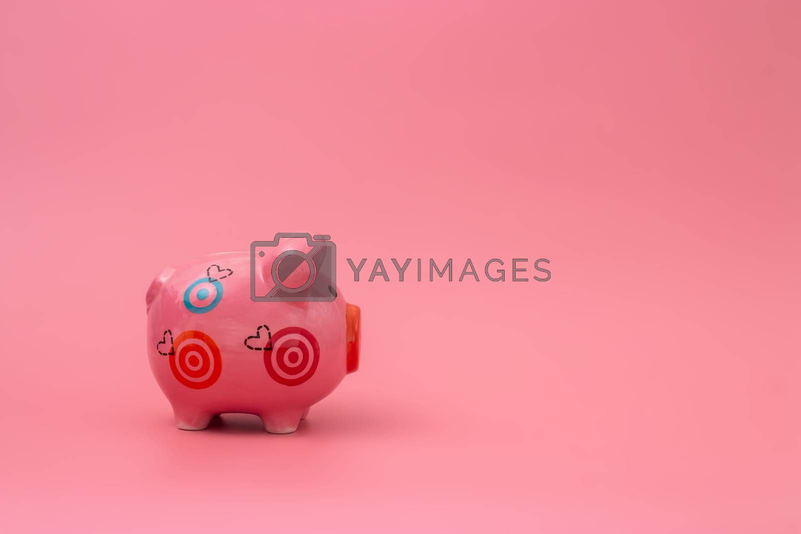 Pink piggy bank on pastel pink background, Financial concepts
