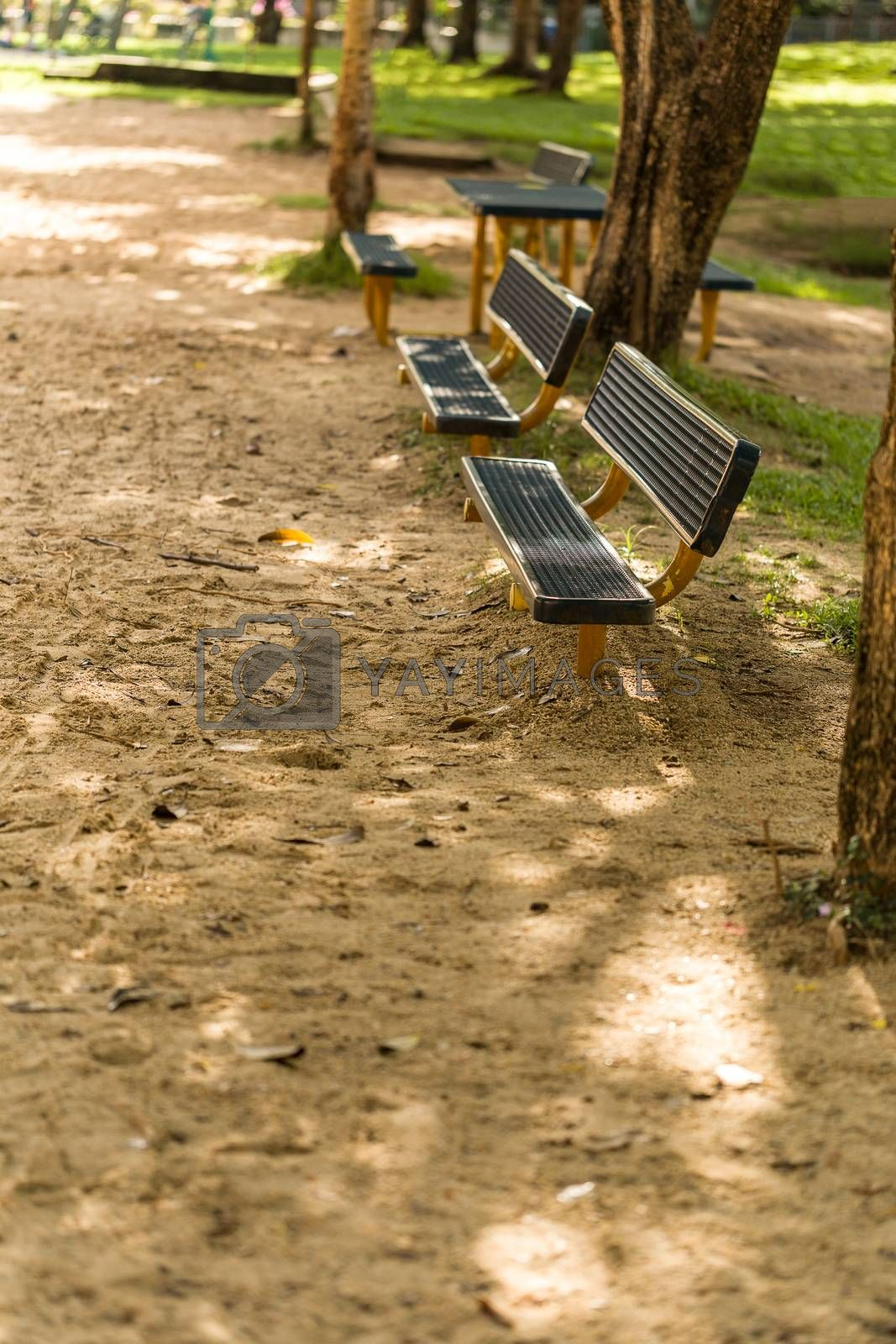 Bench with nobody in park illustrating empty concept.