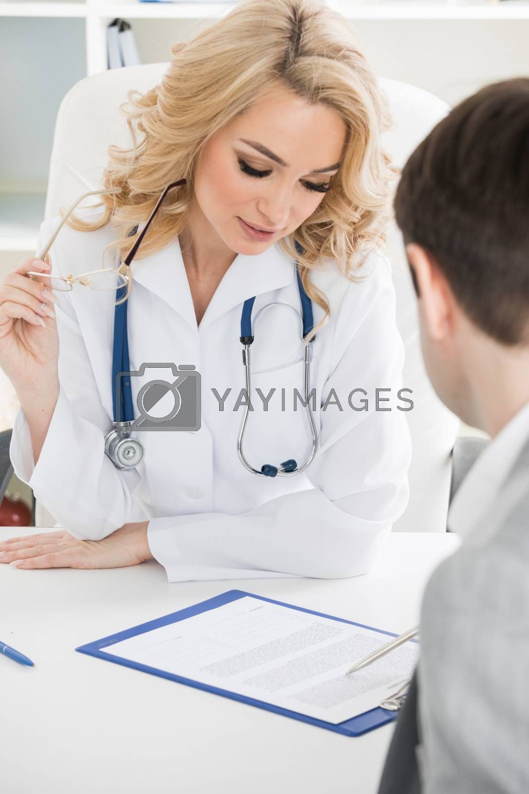 Female doctor and patient reading contract at pad. Physical agreement form signature, disease prevention, ward round reception, consent contract sign, prescribe remedy, healthy lifestyle concept