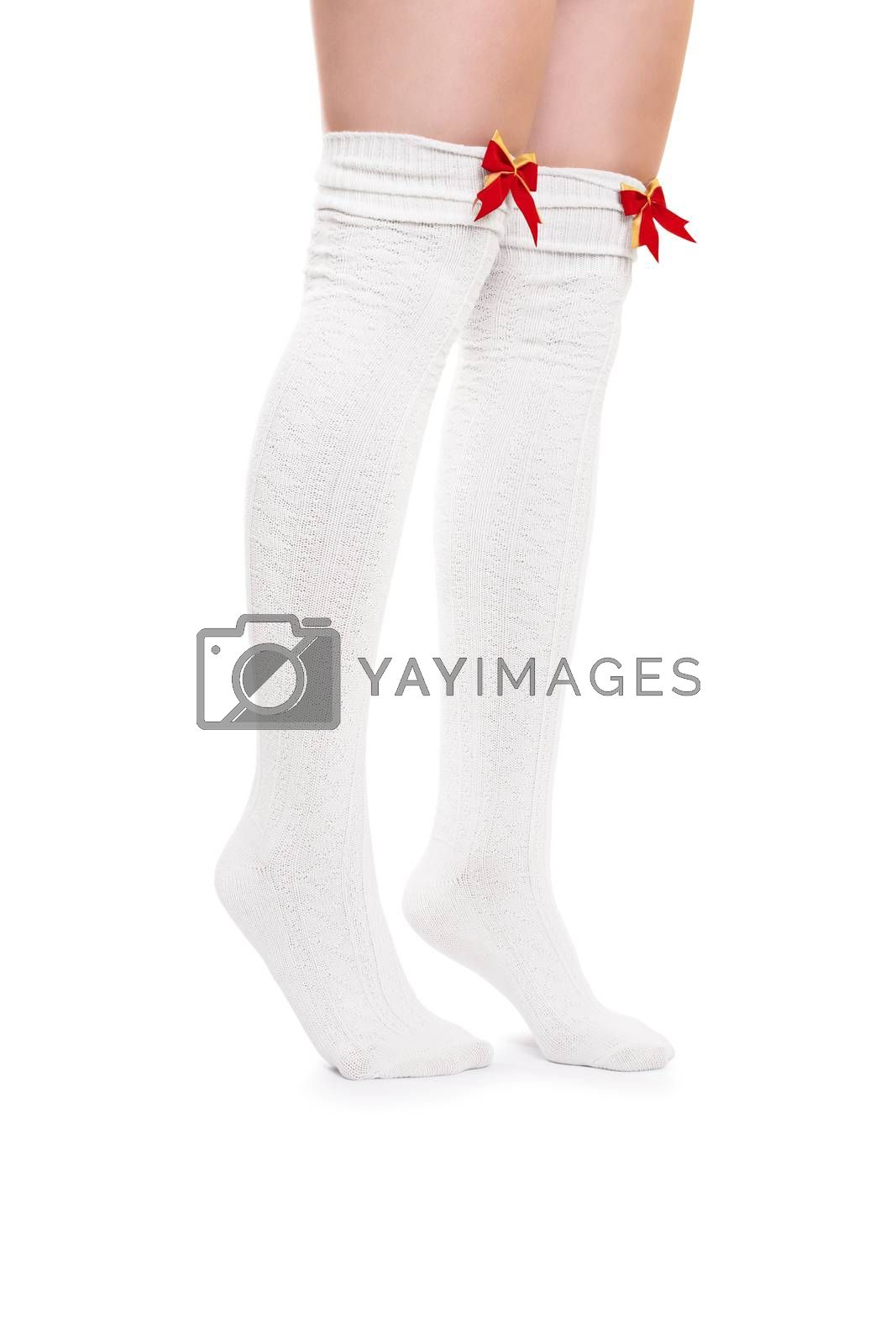 Sexy female legs in white stockings with red bow ties tiptoeing, isolated on white background.