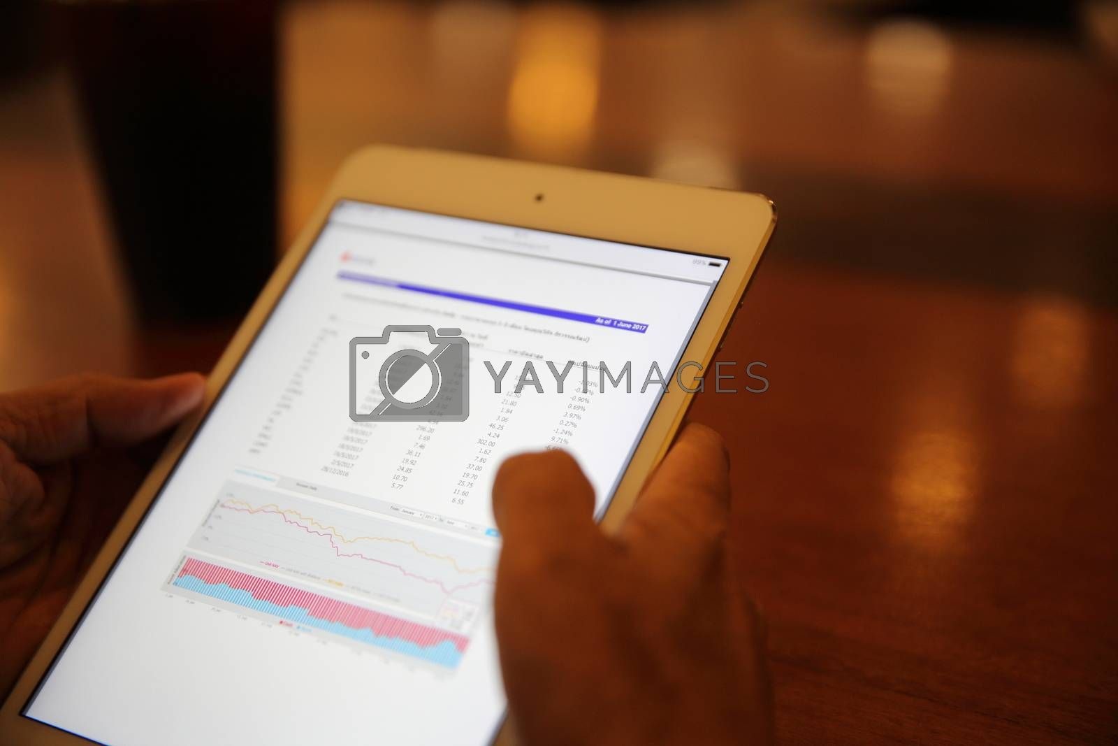 A hand with business tablet