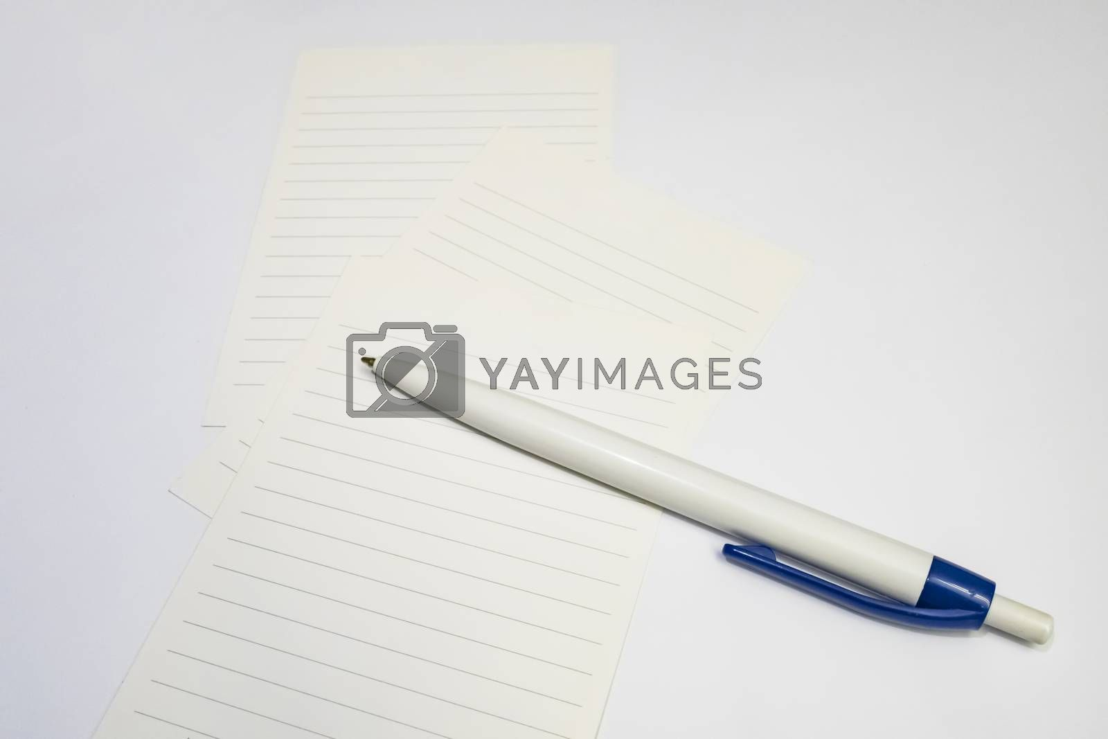 ballpoint pen and note papers