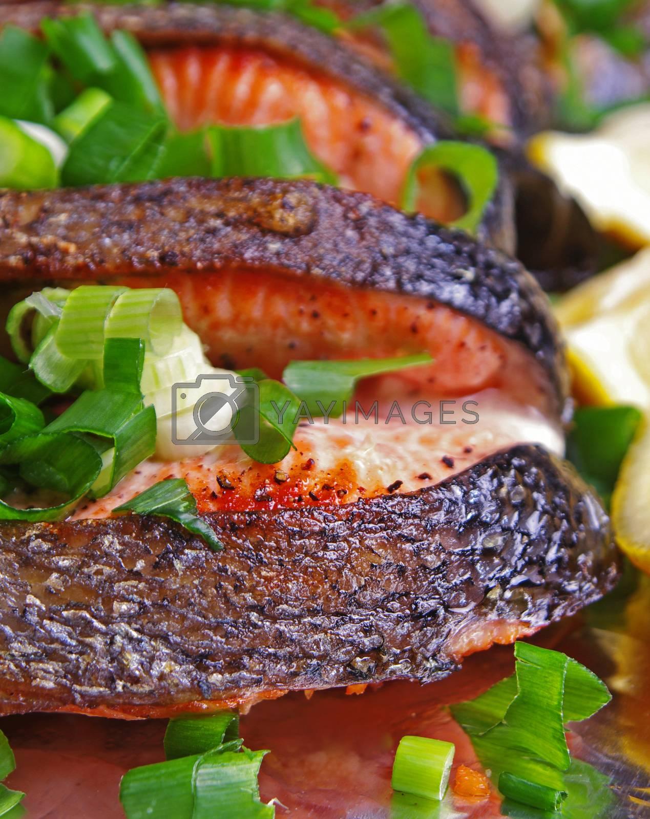 prepared salmon dish with onion