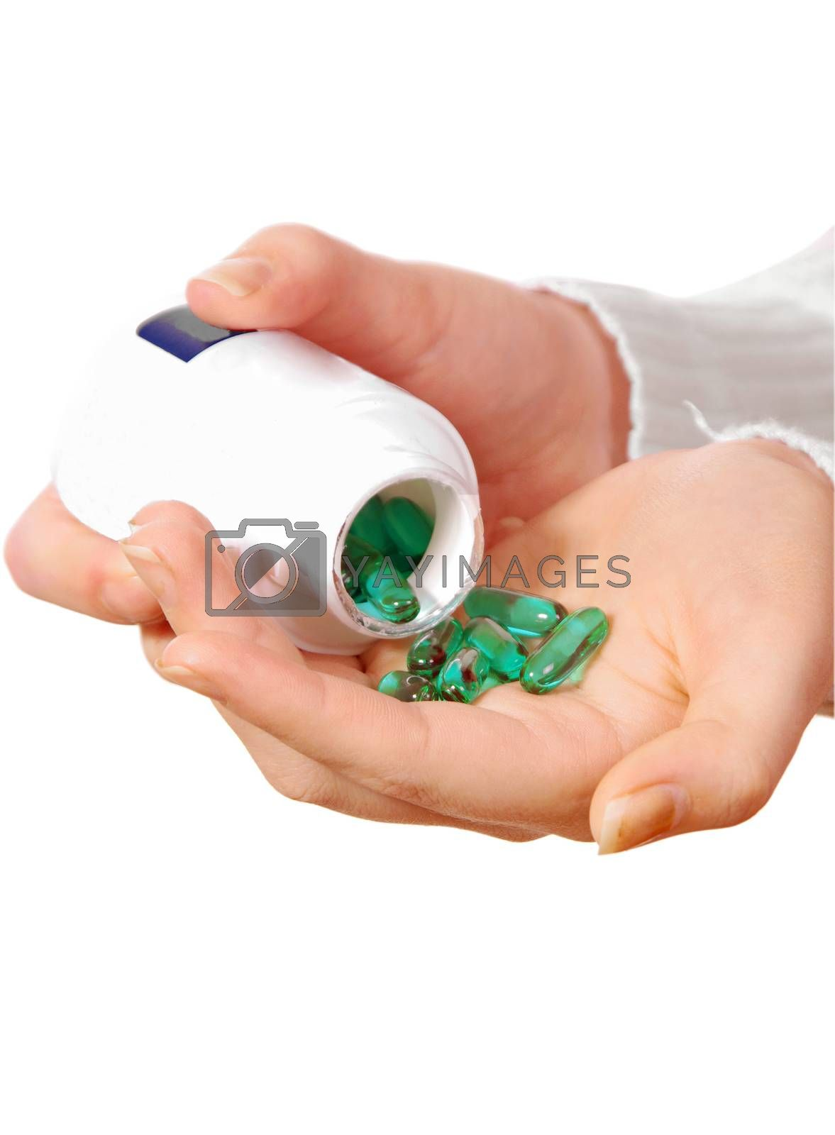 female hand with medicine pills on white