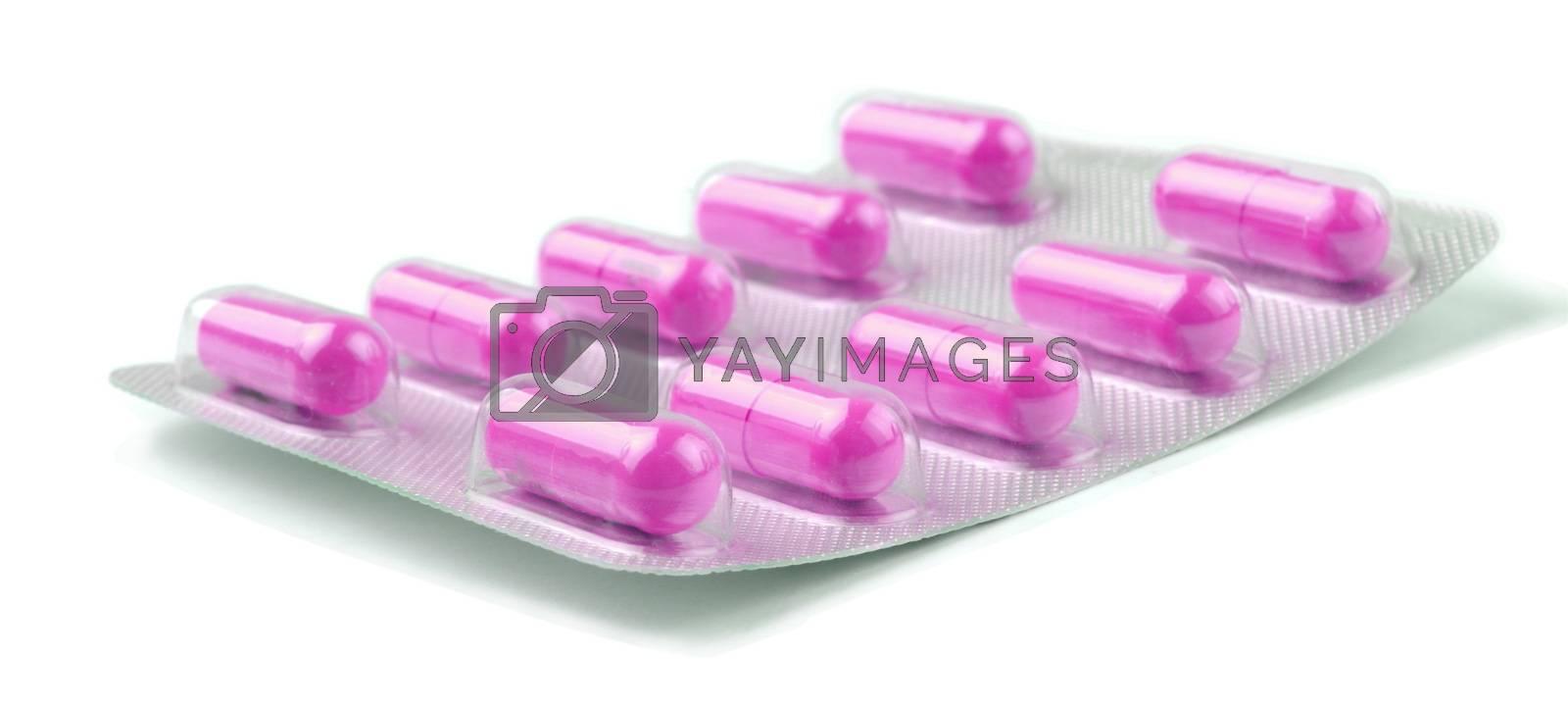 pink  medicine pills over white