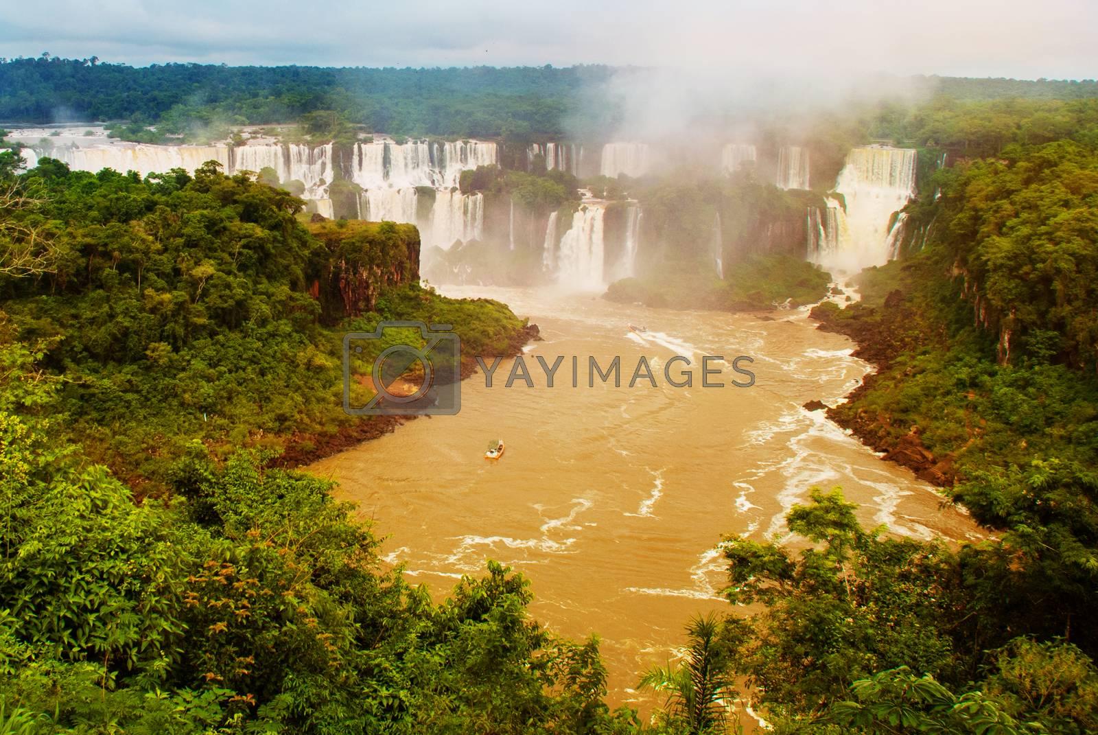 Waterfalls of Iguacu in Brazil. Brazilian side of the waterfalls. Powerful water energy. UNESCO world heritage.