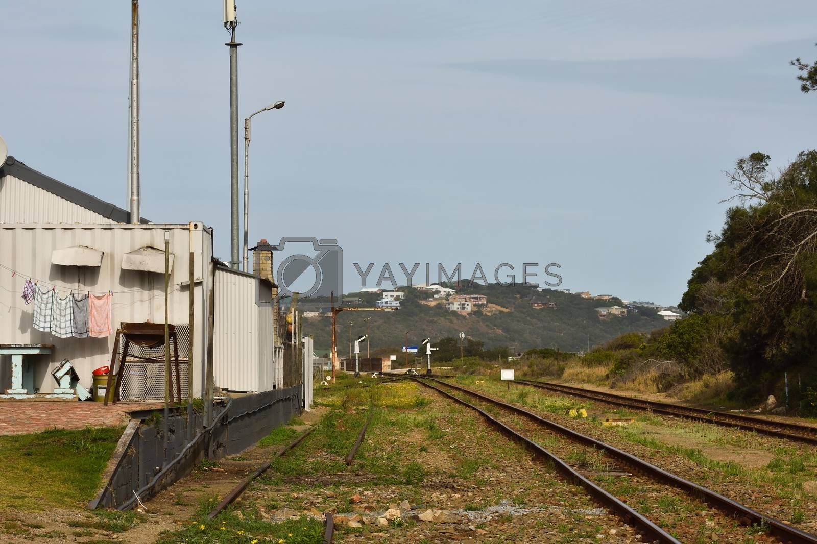 Building and railroad at the old Groot Brakrivier train stop, Mossel Bay, South Africa