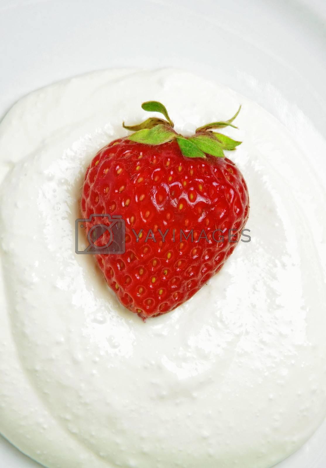 strawberry with cream over white