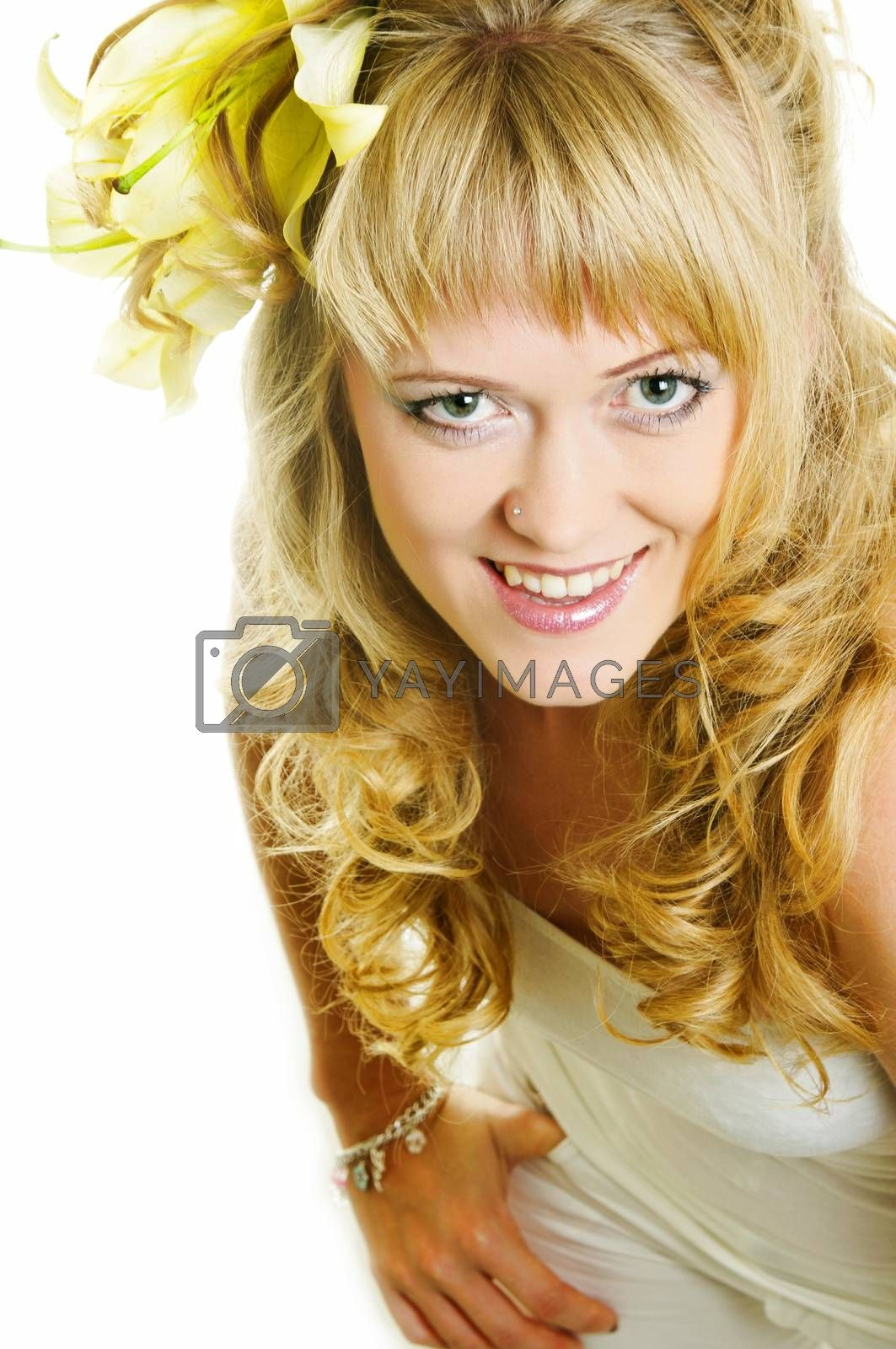beautiful woman with lily flower in hair