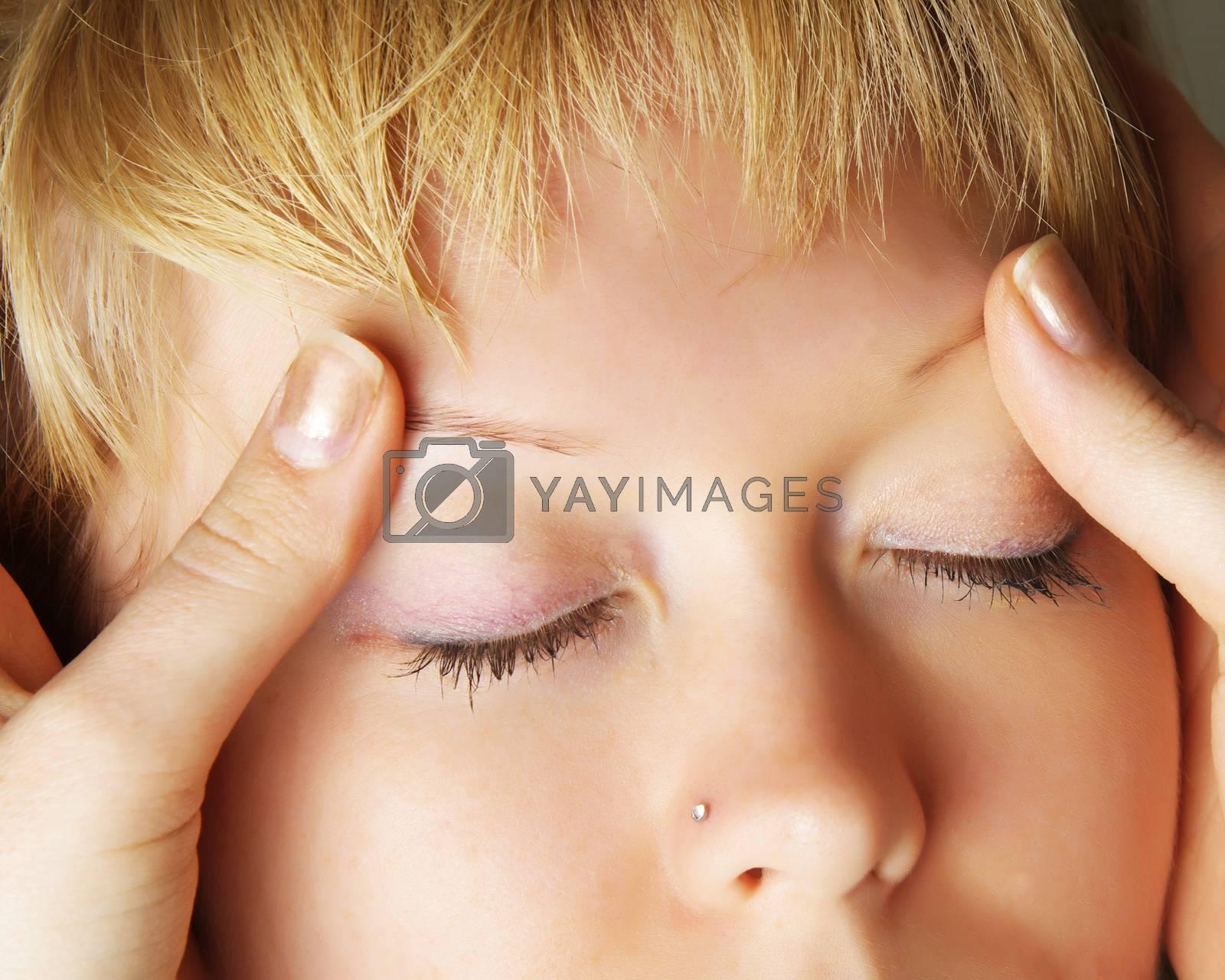 closeup of woman doing facial treatments