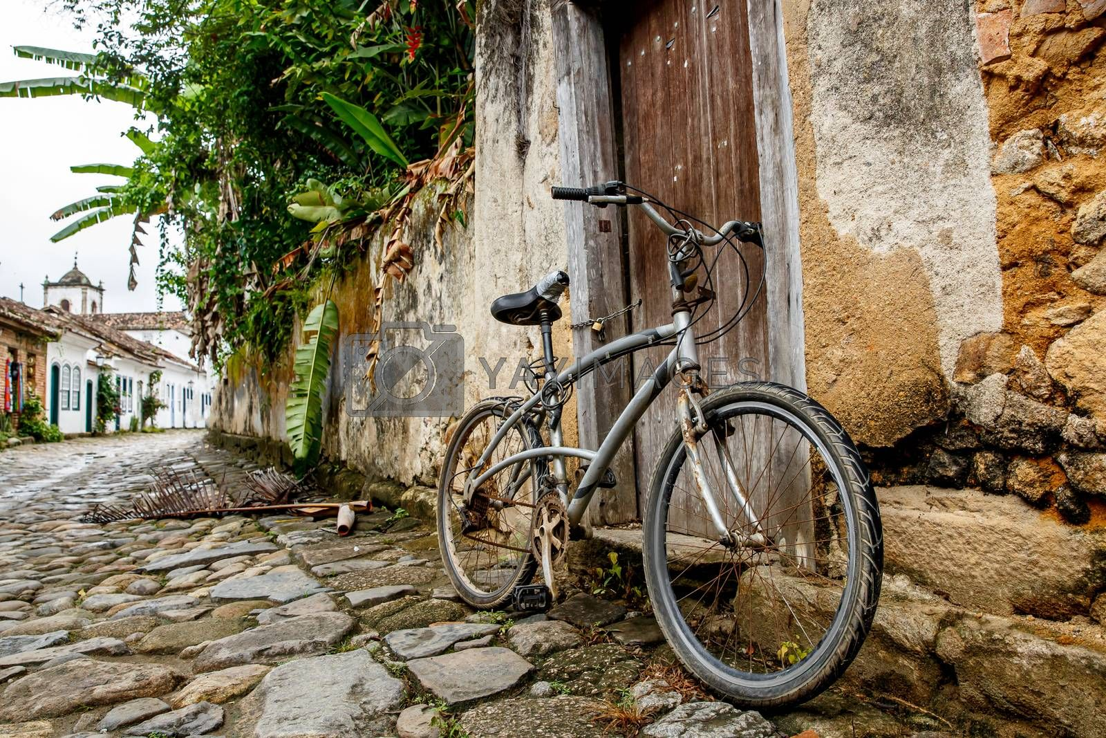 A bicycle parked on an old city street
