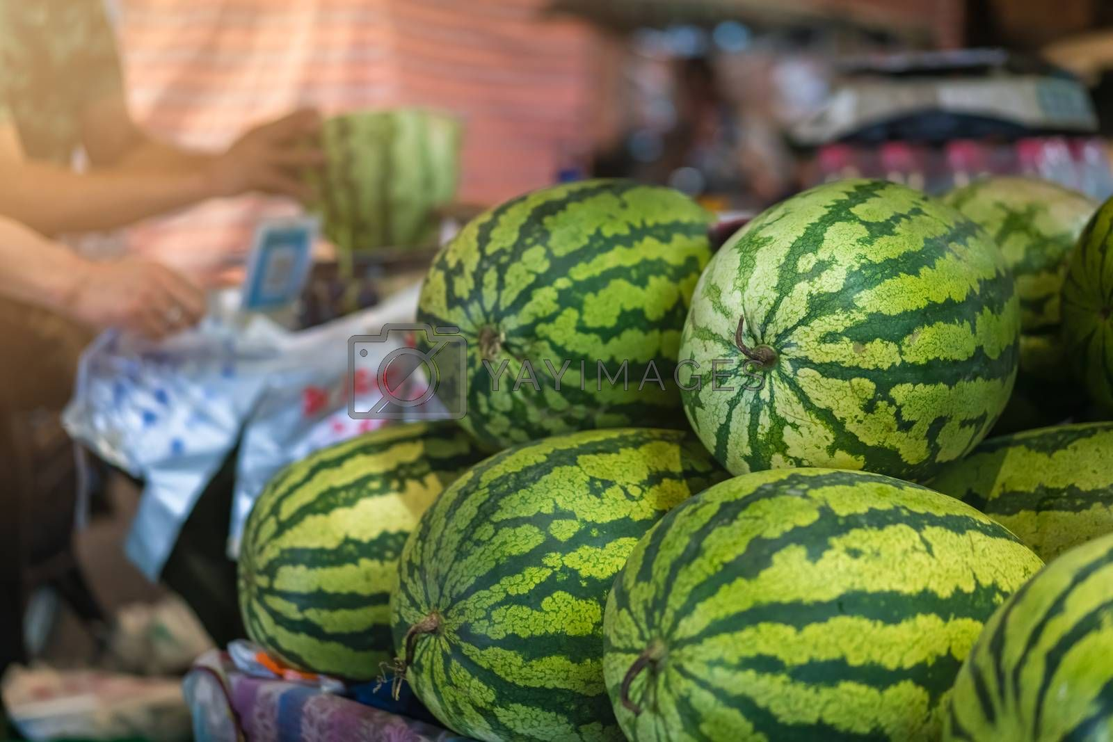 Royalty free image of Huge watermelons for sale on a street in China by pawopa3336