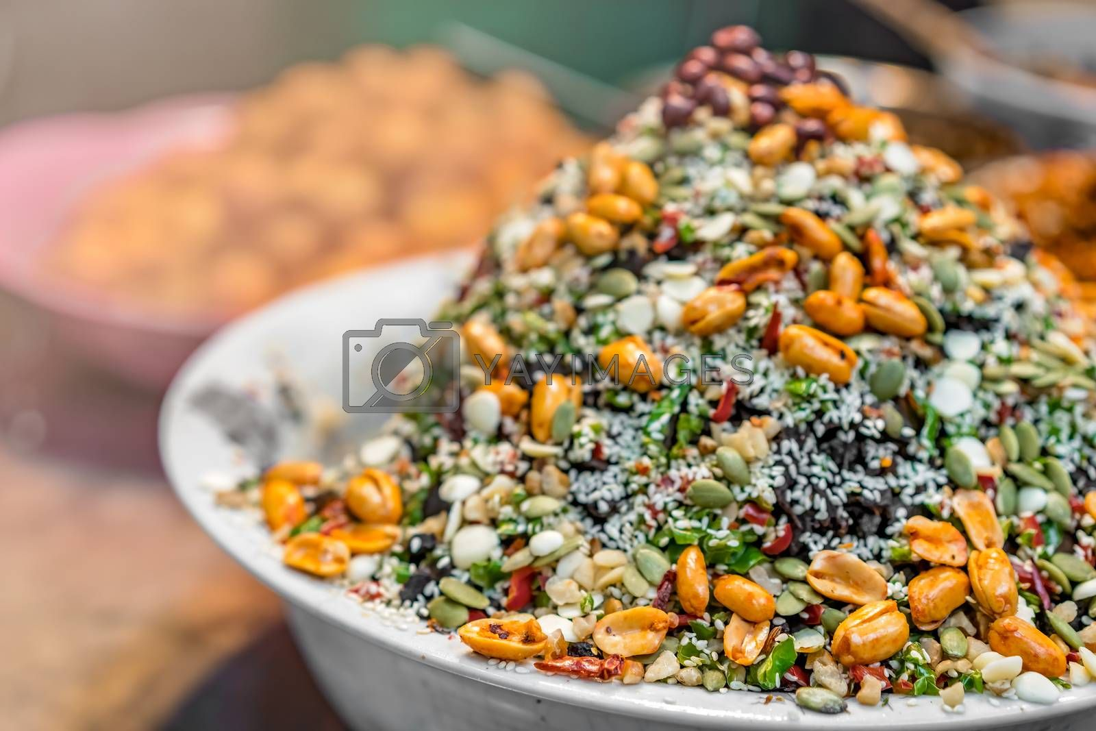 Closeup shot of delicious dessert meal of muesli with  oats, grains, nuts and seeds in a white bowl
