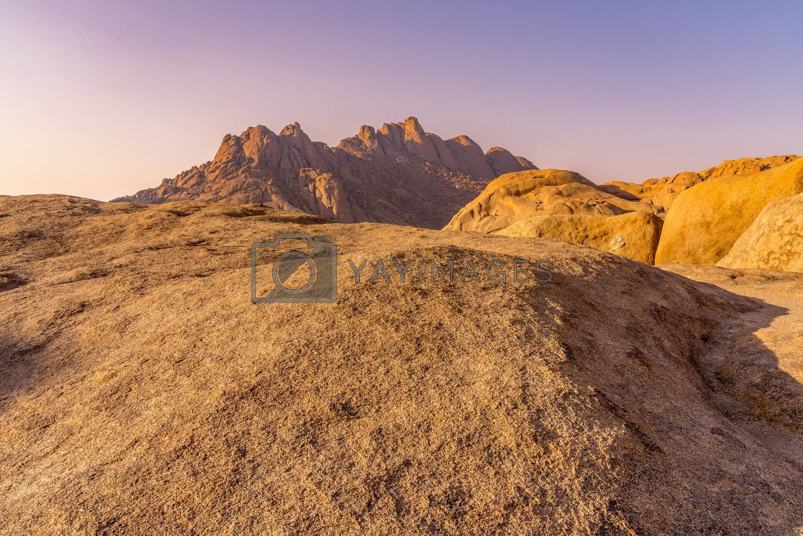 The Pondoks near the Spitzkoppe mountain at sunset in Namibia in Africa.