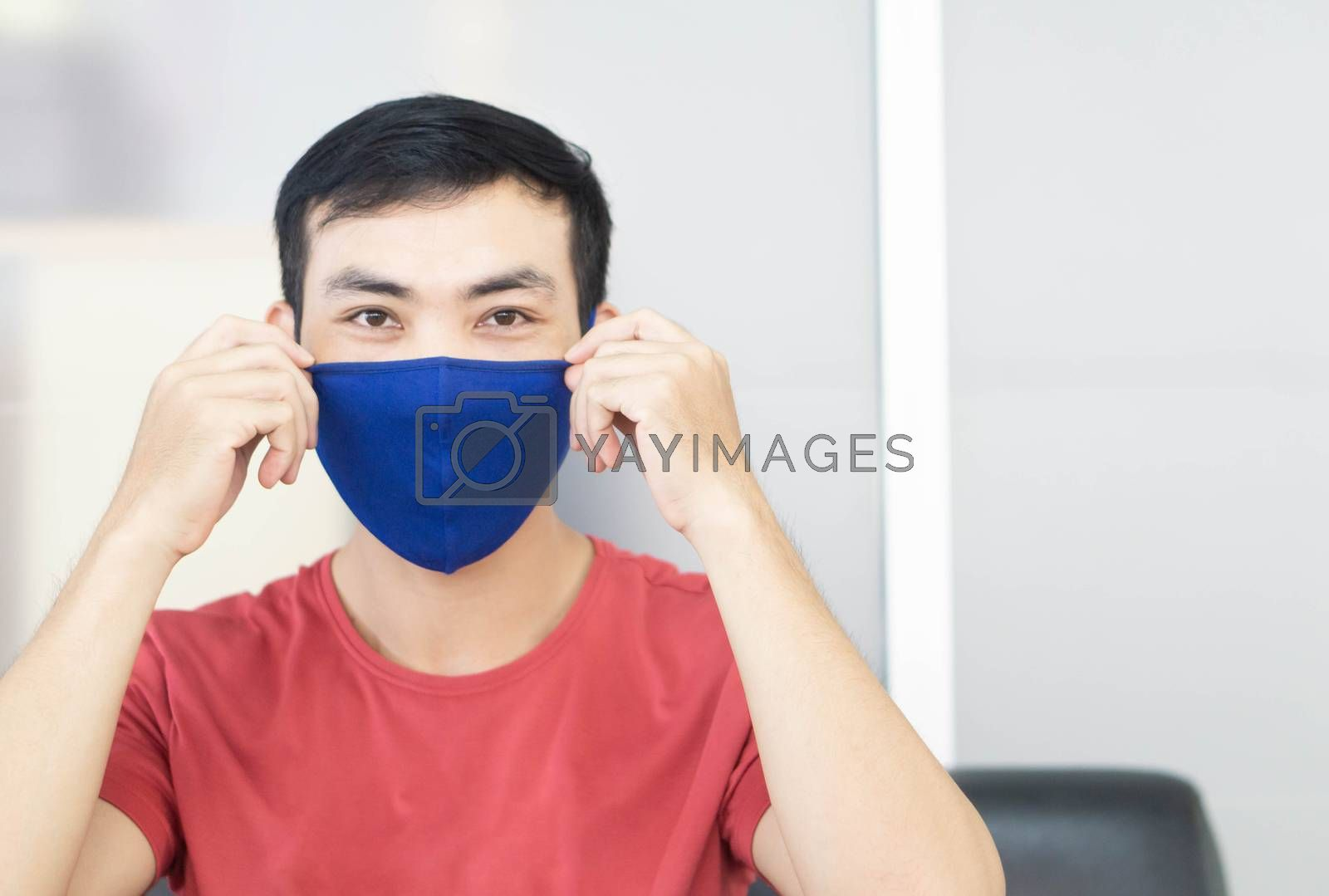 Closeup asian man wearing face mask for protect air polution or virus covid 19, health care and medical concept