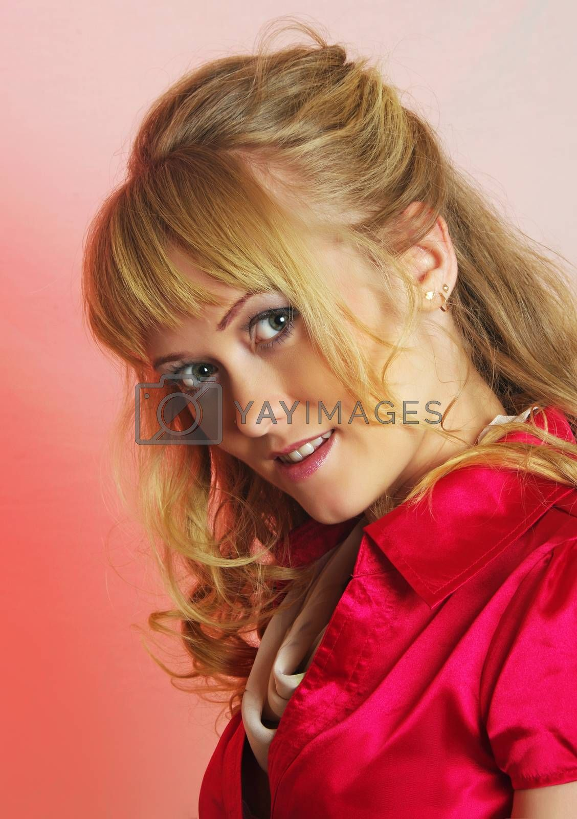beautiful woman in red on pink background