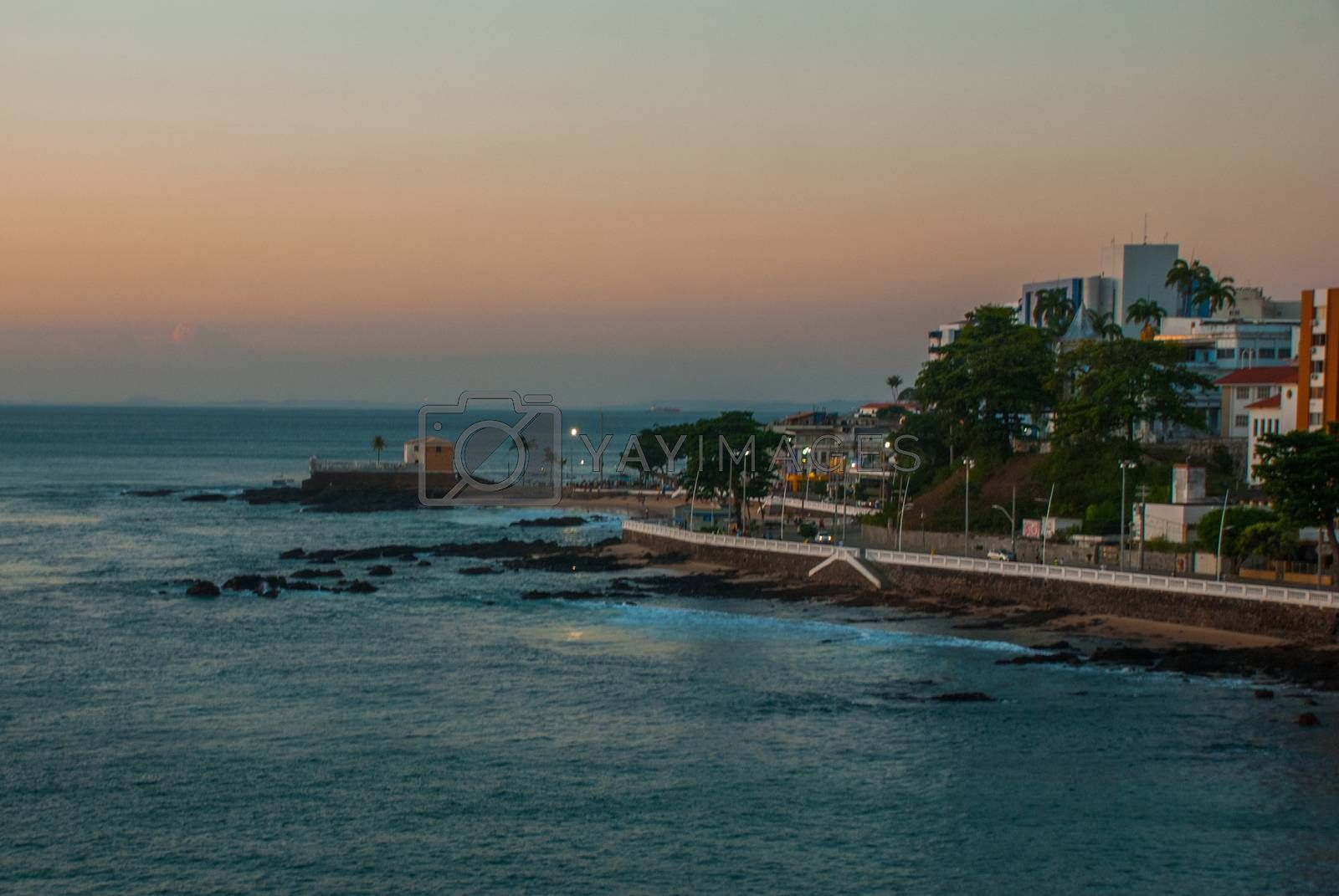 SALVADOR, BAHIA, BRAZIL - MARCH 2019: Beautiful sunset on the sea. Panoramic view of Barra Lighthouse in Salvador