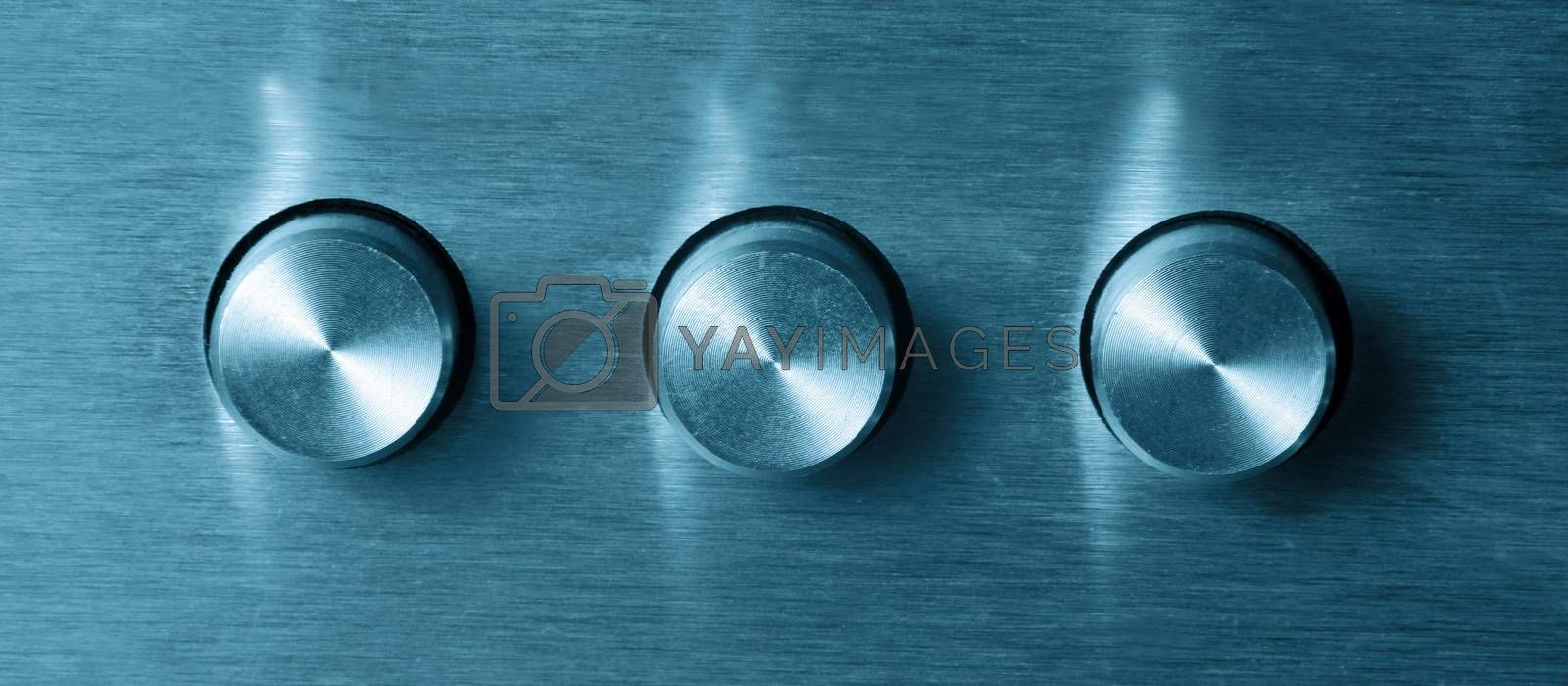 closeup of three electronic round switches