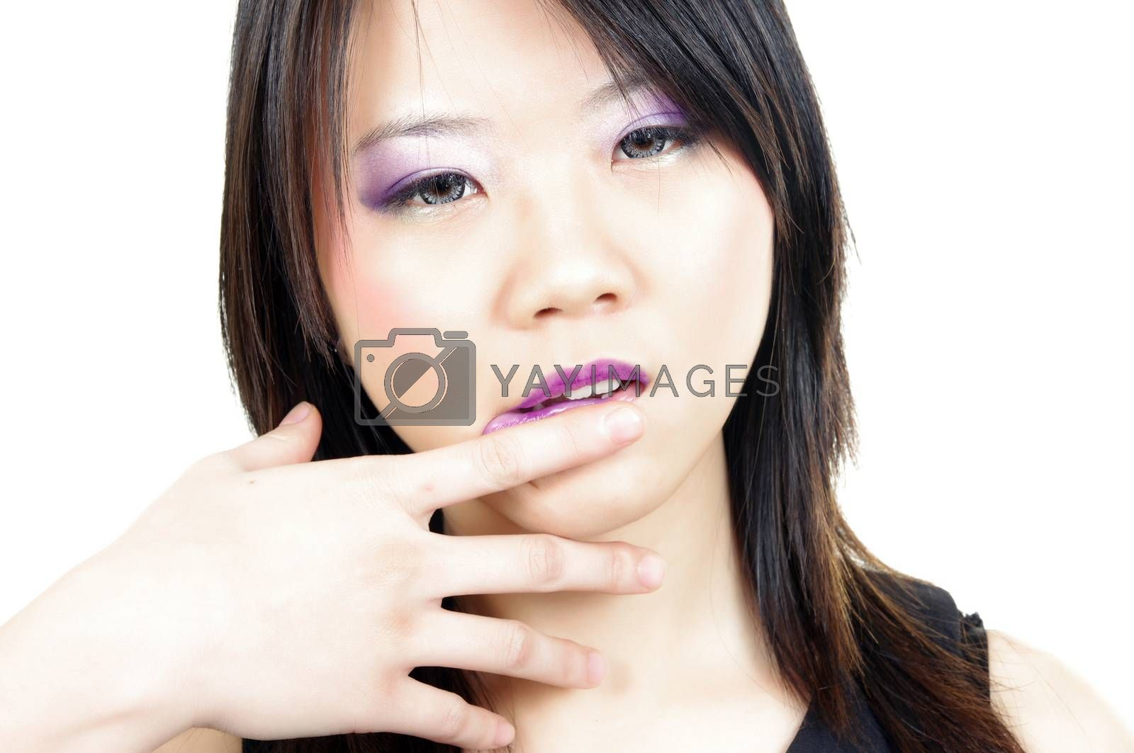 beautiful  asian woman rubbing the lipstick