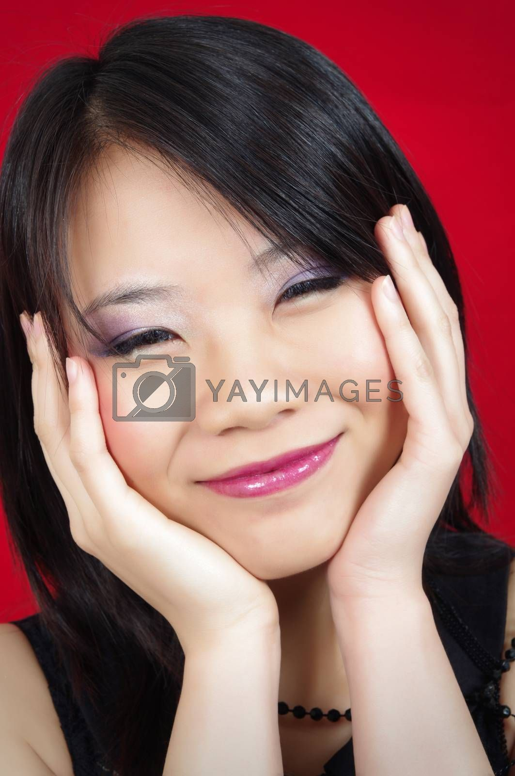 beautiful asian girl portrait on red