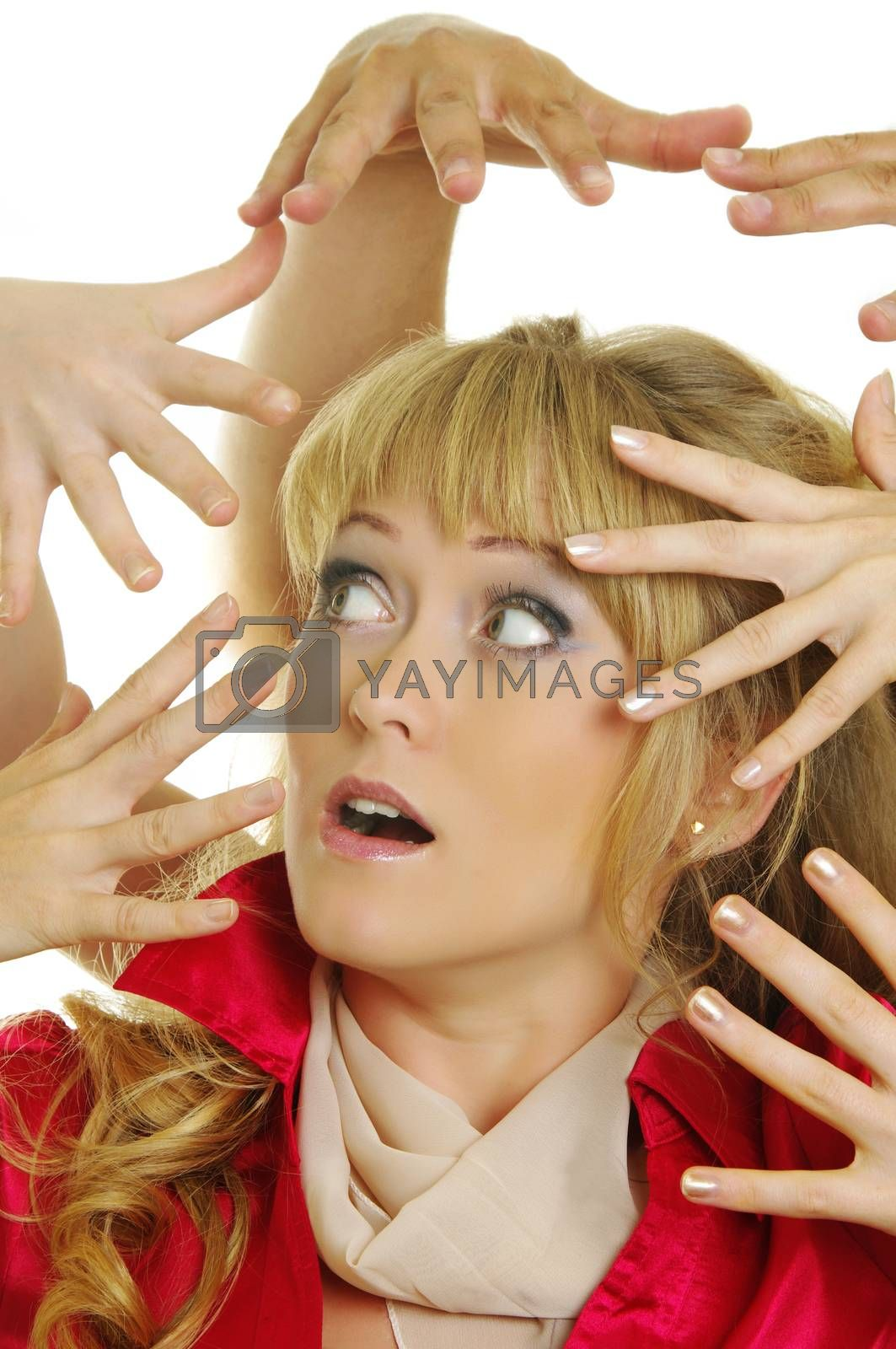 a lot of scary hands over the woman