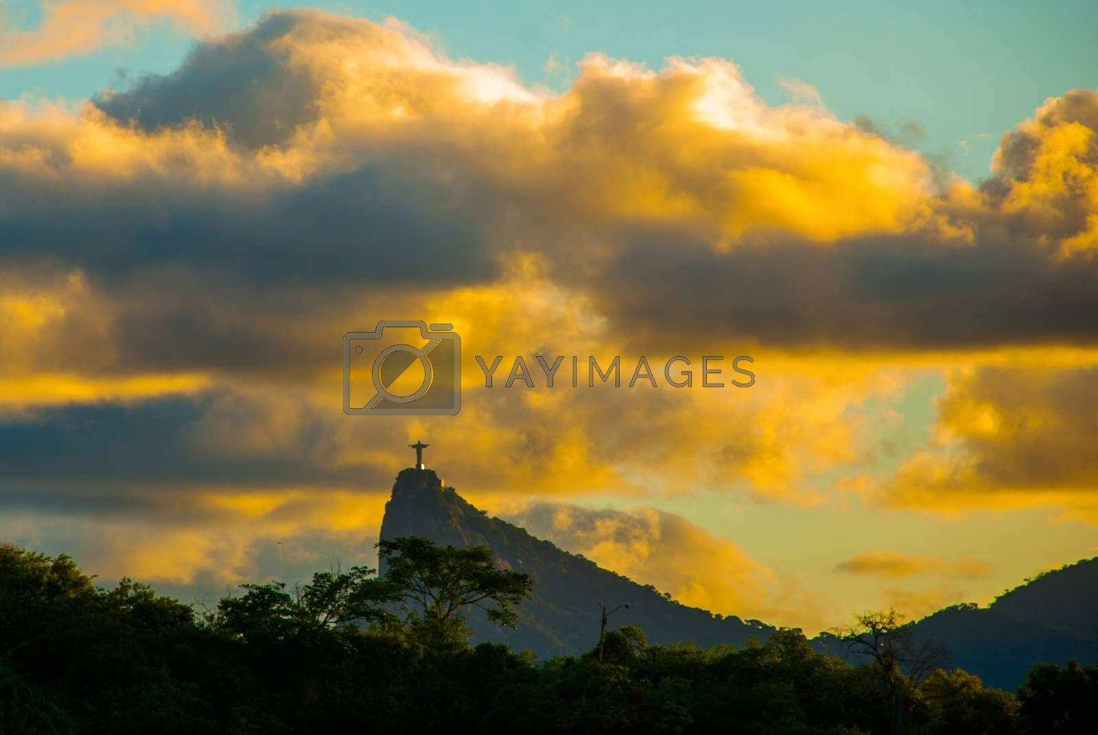 RIO DE JANEIRO, BRAZIL: The famous Rio de Janeiro landmark - Christ the Redeemer statue on Corcovado mountain, shot during beautiful sunset. Beautiful landscape with sunset view.