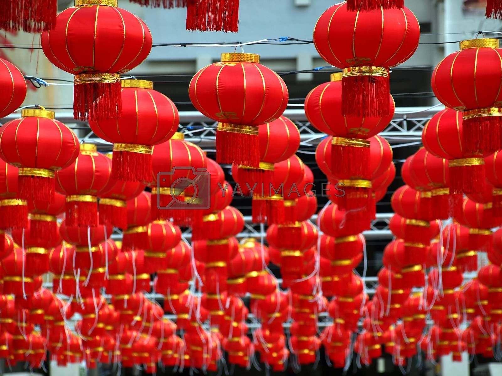A sea of traditional Chinese lanterns at an outdoor feast