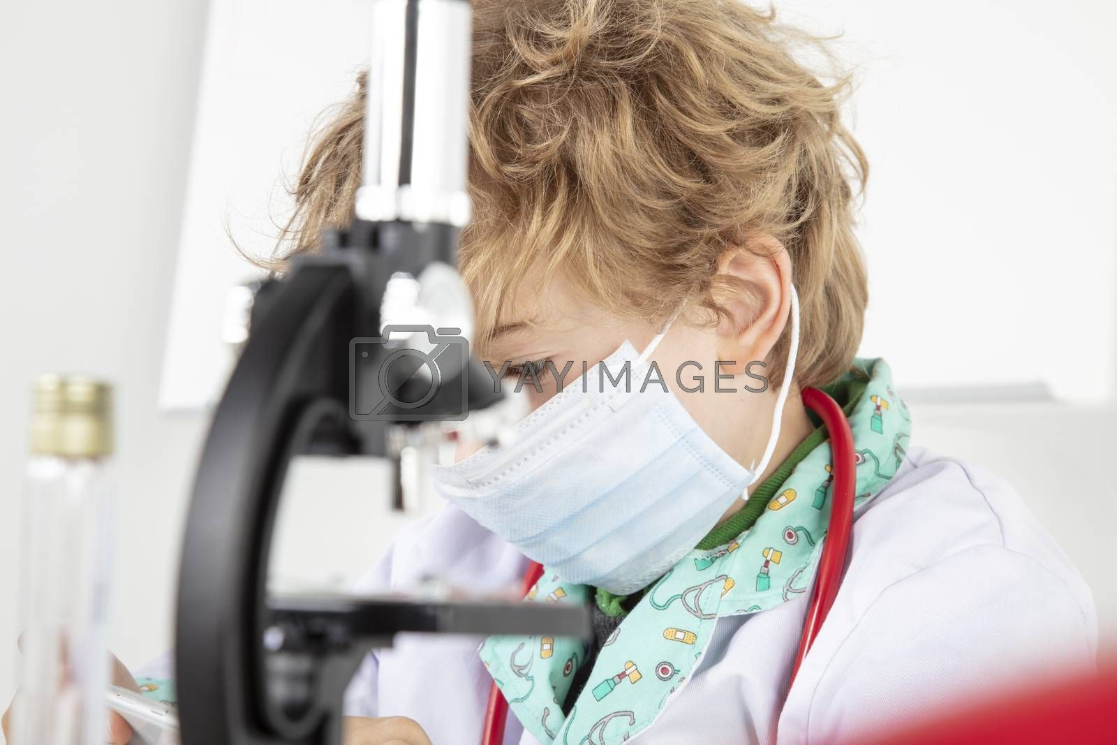 focused young doctor working in a protective mask