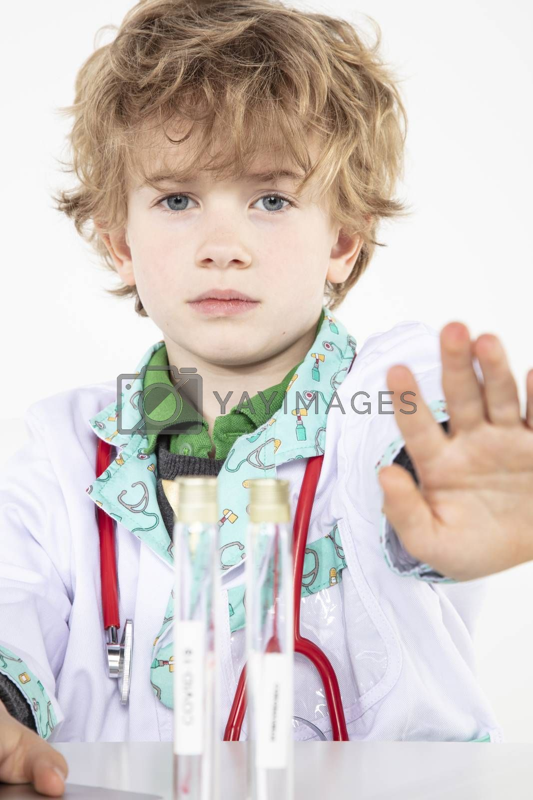 little doctor shows stop sign with his hand