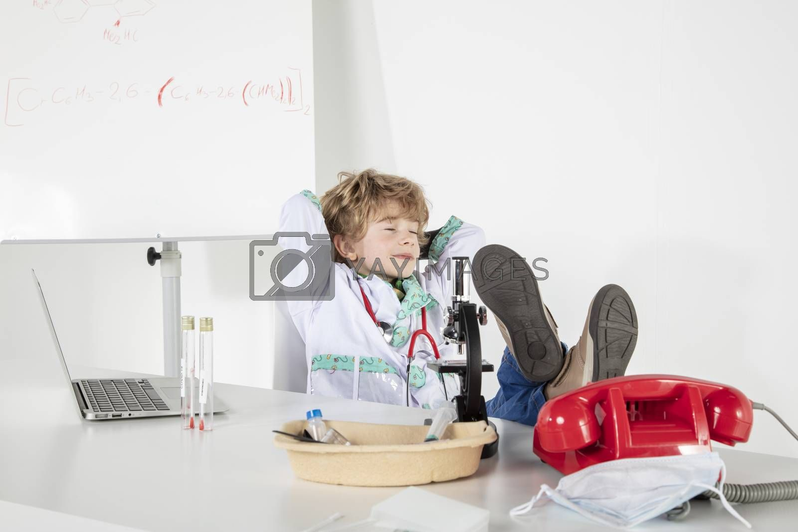 young doctor relaxes in his office, eyes closed, a short nap in the office