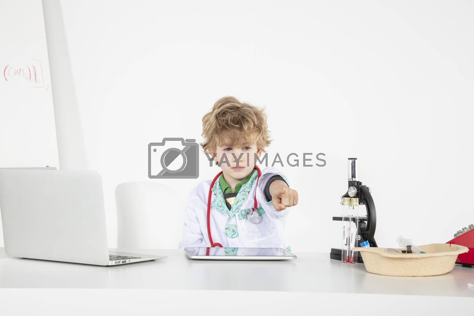 busy young doctor shows a finger at you