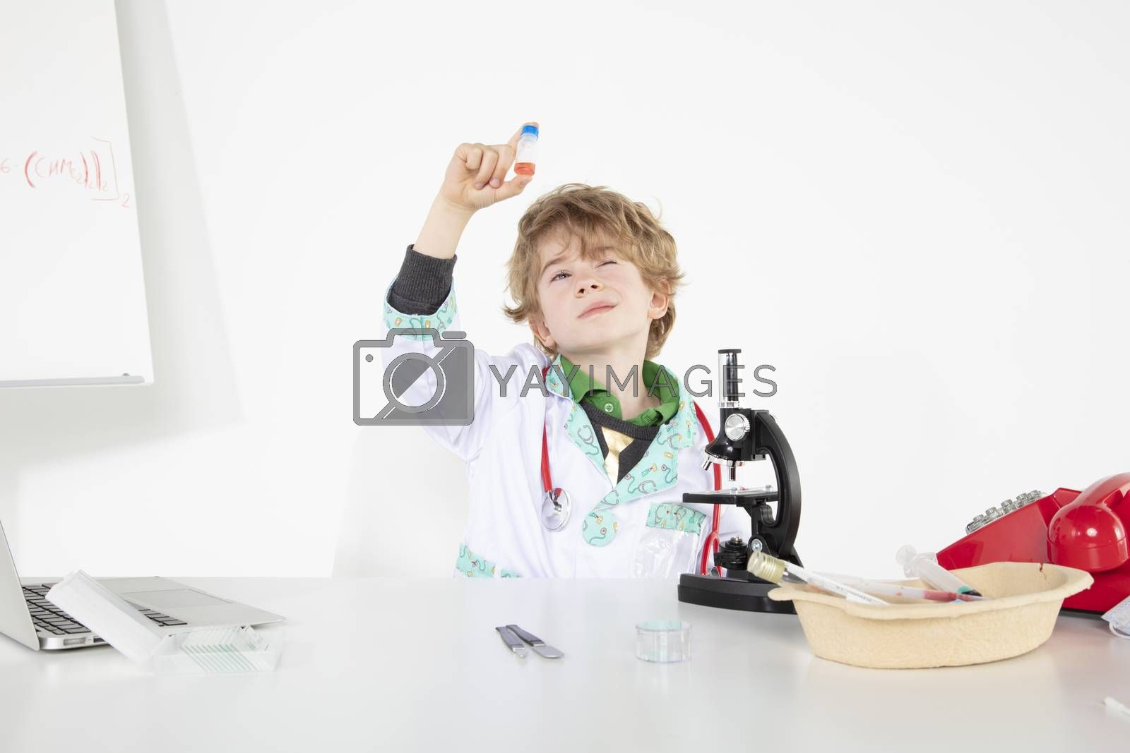 young doctor looks at the finished vaccine in the bottle