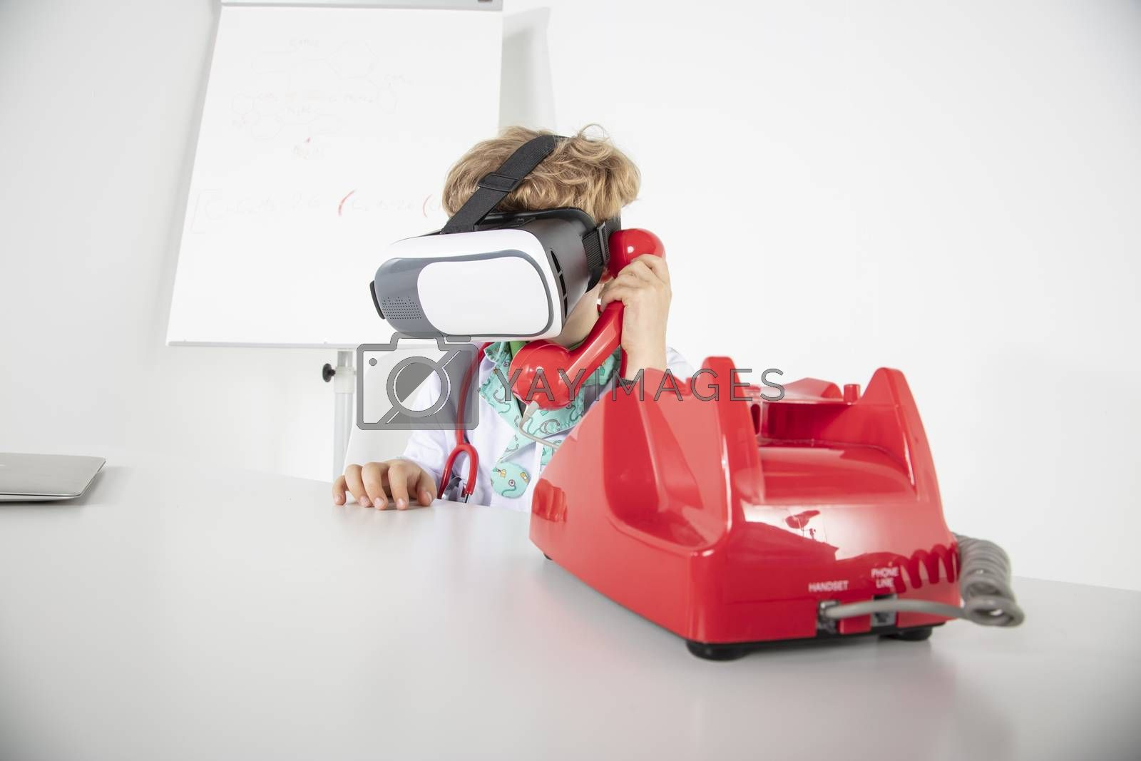young doctor in virtual reality goggles talking on the phone, a symbol of globalization