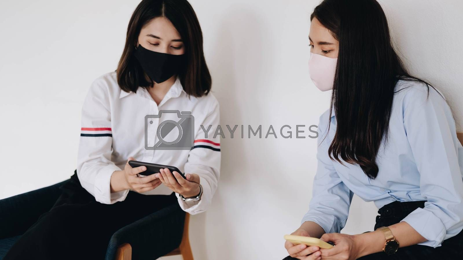 Business meeting. Teamwork. Two businesswoman  sitting at chair  use smartphones. Online education for adult, marketing, distance work, financial planning.