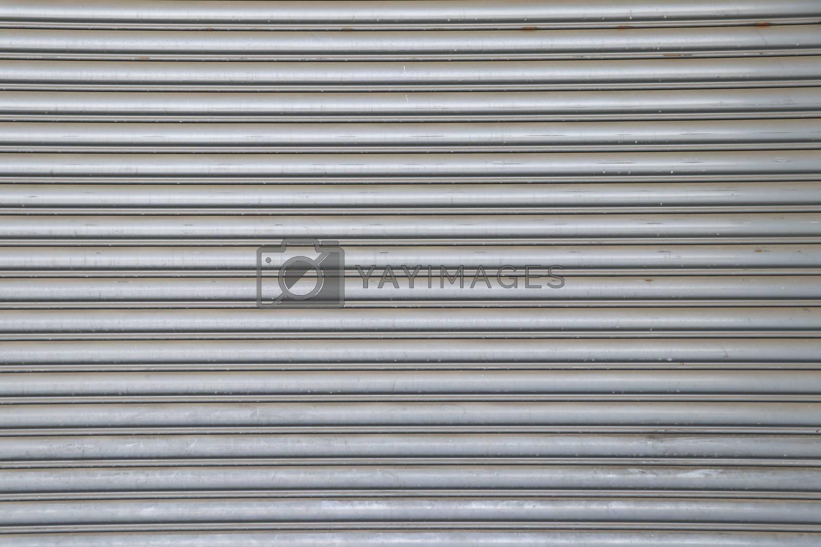 Rolling steel door background. Steel rolling door surface.