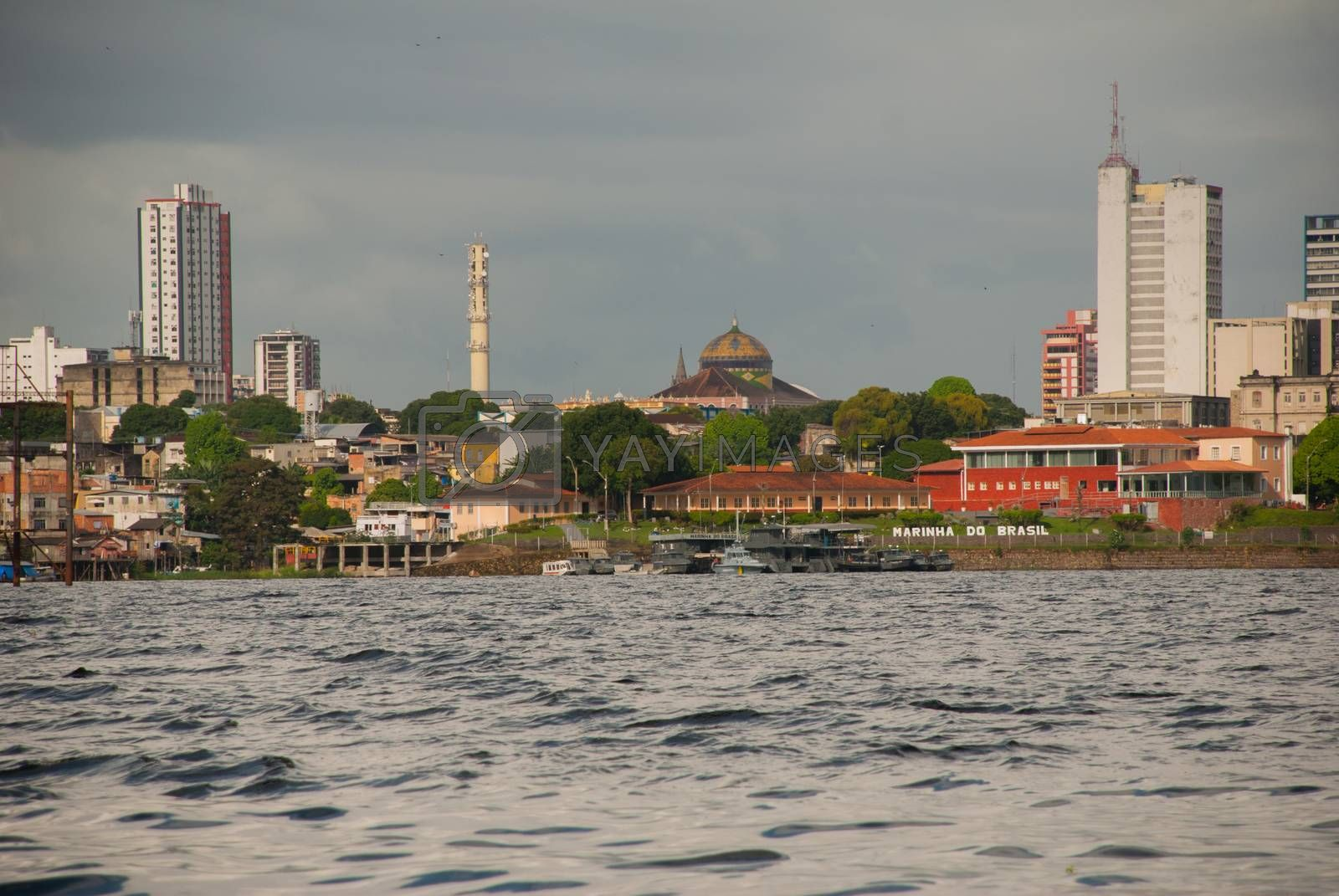 Manaus, Amazonas, Brazil, South America: Manaus Opera House. Popular tourist trip on the ship. View from the boat to the port city of Manaus.