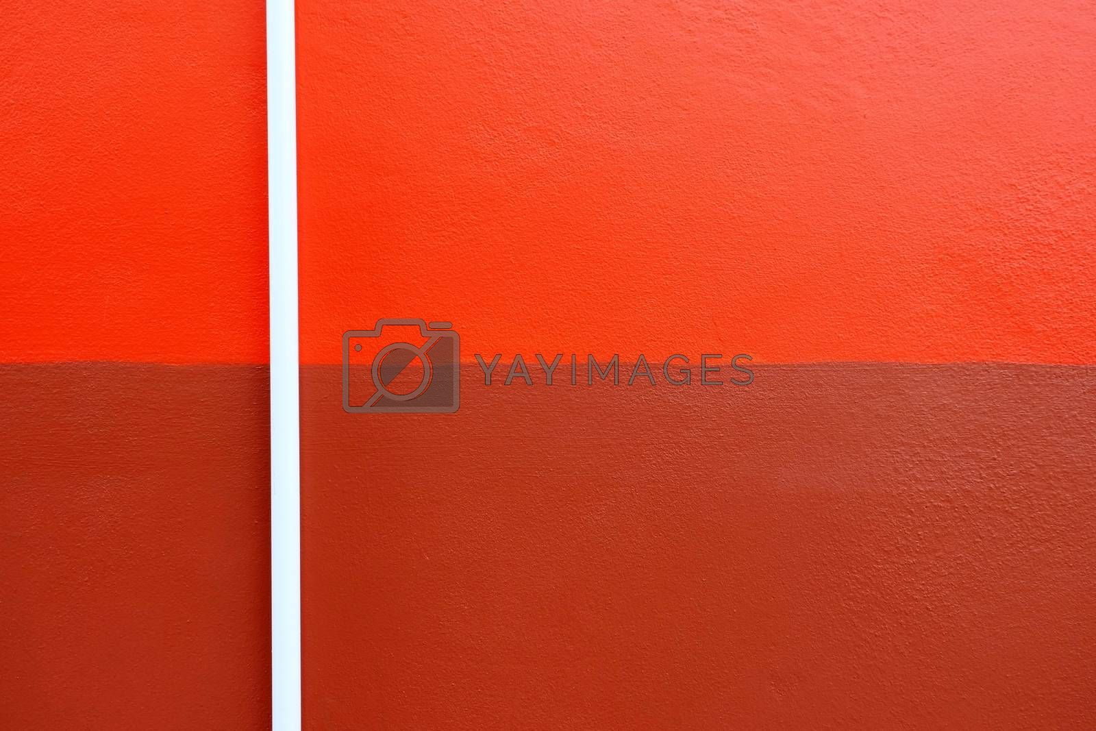 White Plastic Pipe on Two Tone Painted Concrete Wall.