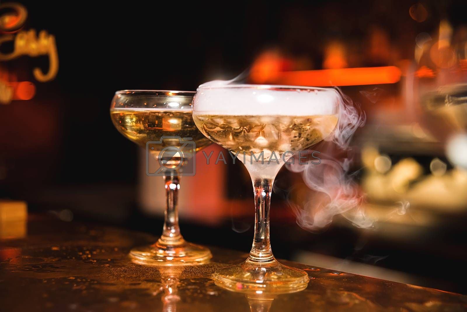 Cocktail with smoke in the night club, night life