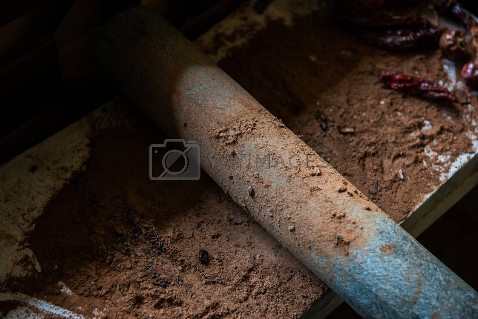 Royalty free image of Grinding cacao beans with chili peppers by rusak