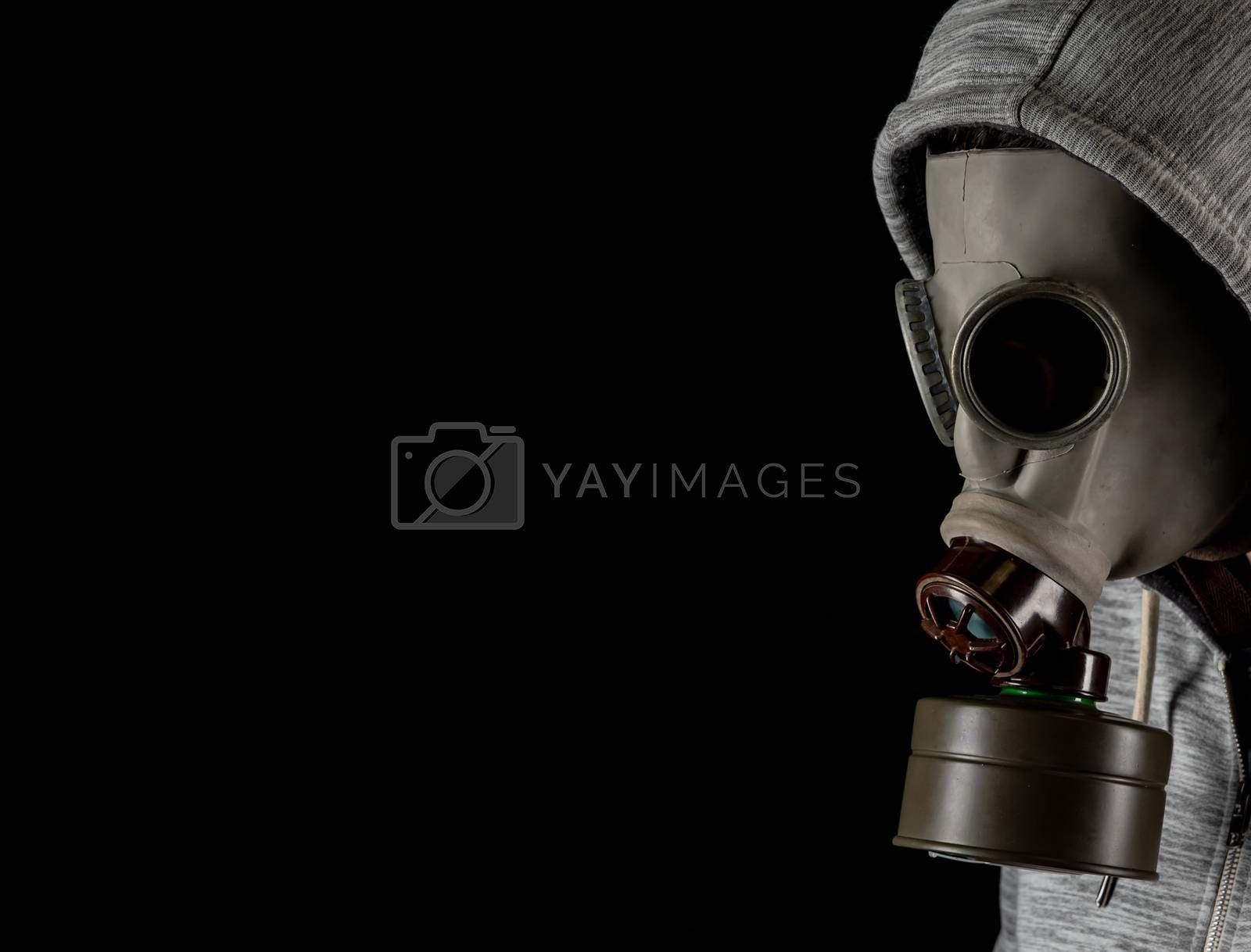 man in a gas mask on a black background. protection against viruses