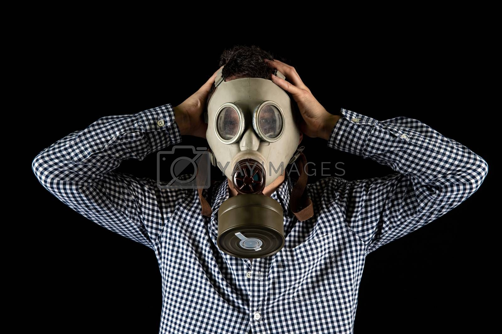 a man in a gas mask is worried about the current situation.